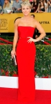 Kaley Cuoco-Sweeting in a red strapless belted Romona Keveza column gown.
