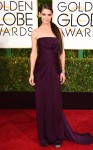 Katie Holmes in a plum strapless Marchesa gown.