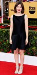 Kelly Macdonald in a black Moschino dress & silver lace-up sandals.