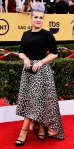 Kelly Osbourne in a black top & an Elisabetta Franchi skirt with custom jewelry by Dana Rebecca Designs.