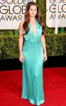 Lana Del Rey in a pleated seafoam halter gown by Versace.