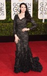 Laura Prepon in a black ruffled long sleeve Christian Siriano gown.