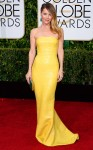 Leslie Mann in a yellow strapless sequined Kaufmanfranco column gown with jewelry by Kimberly McDonald.