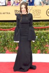 Lorelei Linklater in a black bell sleeved gothic Honor dress.