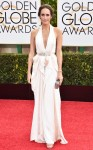 Louise Roe in white ruffled deep-v belted Jenny Packham gown.