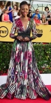 Lupita Nyong'o in a watercolor pleated Elie Saab long sleeve gown.
