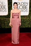 Maggie Gyllenhaal in a rose strapless column gown by Miu Miu.