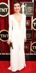 Maggie Gyllenhaal in a white long sleeve Thakoon gown & animal print minaudiere.