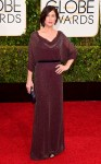 Maura Tierney in a merlot belted Jenny Packham 40s inspired dress.
