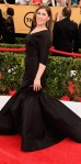 Mayim Bialik in a black Christian Siriano mermaid dress with jewelry by Ivanka Trump.