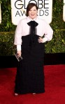 Melissa McCarthy in a black & white tiered skirted dress.