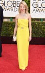Naomi Watts in a yellow strapless belted Gucci column gown & snake necklace by Bulgari.