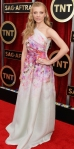 Natalie Dormer in a watercolor floral one-shoulder gown by Naeem Khan & Kimberly McDonald jewelry.