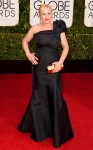 Patricia Arquette in a black one-shoulder Escada gown.