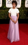Quevenzhane Wallis in a Giorgio Armani belted dress in white & lavendar.