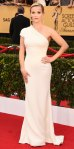 Reese Witherspoon in a white custom Giorgio Armani one-shoulder gown with jewelry by Harry Winston.