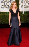 Rene Russo in a black v-neck gown.