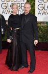 Robin Wright in a black long sleeved crop top with a black gown skirt.