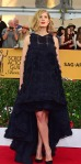 Rosamund Pike in a navy high low gown by Dior.