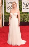 Rosamund Pike in a white cut-out Vera Wang gown with Fred Leighton jewelry.