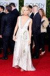 Sienna Miller in a ivory silk duchesse gown by Miu Miu with jewelry by Tiffany & Co. & Jimmy Choo sandals.