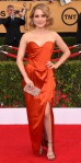 Sophia Bush in a rust strapless slit dress by Vivienne Westwood with an Edie Parker clutch & Irene Neuwirth jewelry.