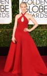Taylor Schilling in a red halter Ralph Lauren gown with Salvatore Ferrragamo shoes.
