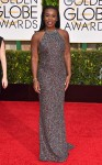 Uzo Aduba in a metallic Randi Rahm column gown.
