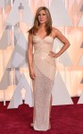 Jennifer Aniston in a nude beaded sweetheart Versace column gown.