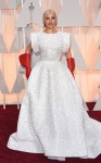 Lady Gaga in a custom made white & silver Azzedine Alaia gown with red gloves.