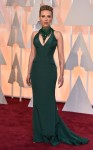 Scarlett Johansson in an emerald green Versace gown with a statement necklace.