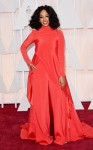 Solange Knowles in a red long sleeve crepe jumpsuit by Christian Siriano.