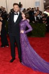 Alison Brie in a purple long sleeved beaded & sequin gown by Prabal Gurung & Joel McHale at the 2015 Met Gala. 01.