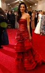 Amal Clooney in a red leather corset & ruffled tiered gown by John Galliano for Margiela at the 2015 Met Gala. 01.