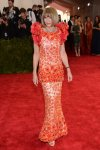 Anna Wintour in a coral beaded & feathered Chanel Haute Couture dress at the 2015 Met Gala. 01.