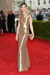 Anne Hathaway in a gold lamé hooded Ralph Lauren gown with a Benedetta Bruzziches clutch at the 2015 Met Gala. 01.