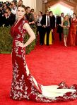 Bee Shaffer in a burgundy & Cream custom Alexander McQueen dress at the 2015 Met Gala. 01.