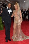 Beyonce in a sheer lace & embellished Givenchy gown & Jay-Z at the 2015 Met Gala. 01.