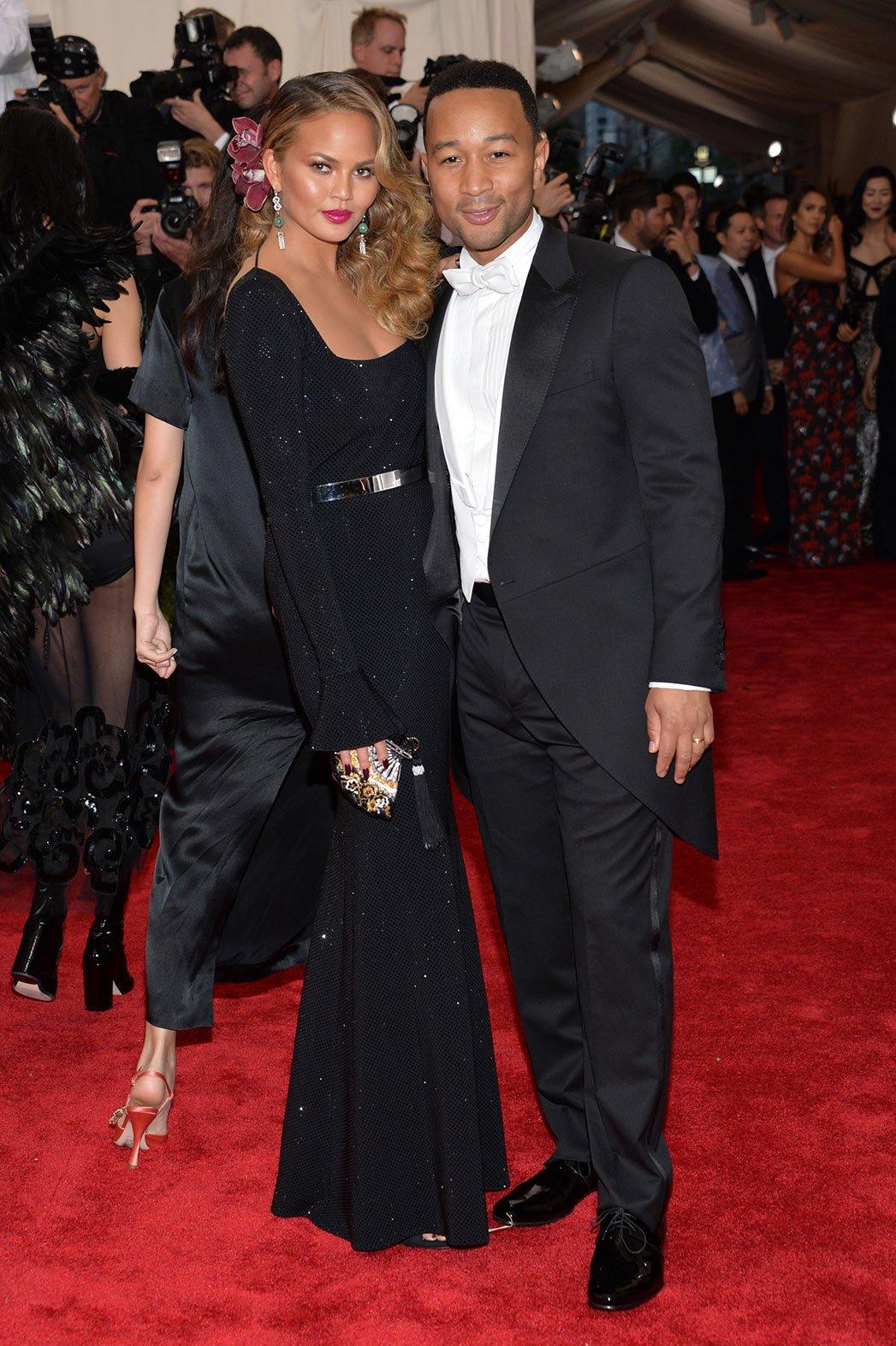 Chrissy Teigen in a black gown by St. John Knits & John Legend at ...