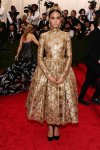 Courtney Eaton in a gold long sleeve tea-length brocade dress at the 2015 Met Gala. 01.