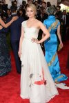 Dianna Agron in a white bird-designed chiffon Tory Burch one-shoulder gown at the 2015 Met Gala. 01.
