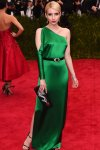 Emma Roberts in a one-shoulder green belted gown by Ralph Lauren with an embroidered clutch at the 2015 Met Gala. 01.