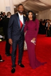 Gabrielle Union  in a merlot long sleeve column dress by Zac Posen with a Charlotte Olympia clutch & Dwyane Wade at the 2015 Met Gala. 01.