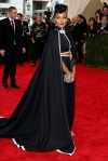 Janelle Monae in a black custom H&M cape look at the 2015 Met Gala. 02.