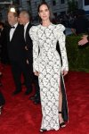 Jennifer Connelly in a white lace strong-shouldered high slit dress by Louis Vuitton at the 2015 Met Gala. 01.