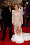 Kim Kardashian in a silver lace & feathered Roberto Cavalli gown & Kanye West at the 2015 Met Gala. 02.