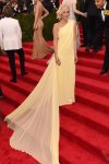 Kristen Wiig in a pale yellow chiffon gown by Prabal Gurung at the 2015 Met Gala. 01.