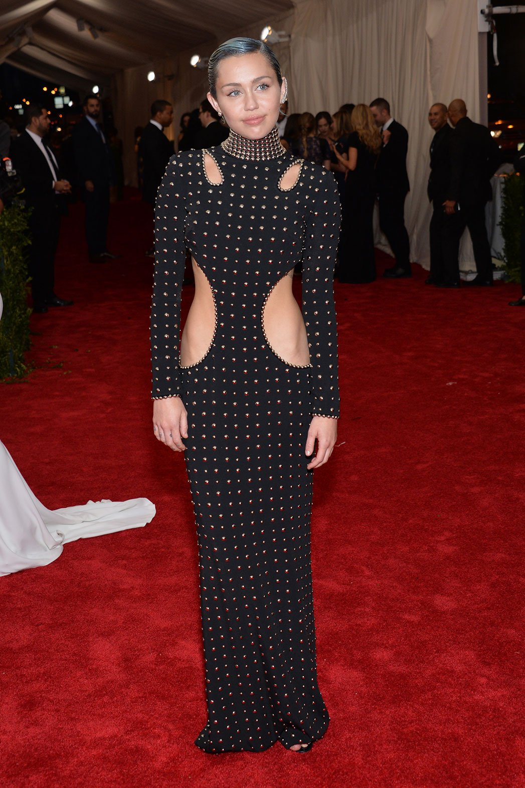 Miley Cyrus in a black studded cut-out dress by Alexander Wang at ...