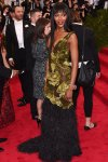 Naomi Campbell in a gold & black feathered Burberry gown at the 2015 Met Gala. 01.