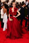 Poppy Delevingne in a scarlett flowered Marchesa at the 2015 Met Gala. 01.